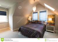 Bedroom With Bed, Bedside Tables, Vaulted Ceiling, Window ...