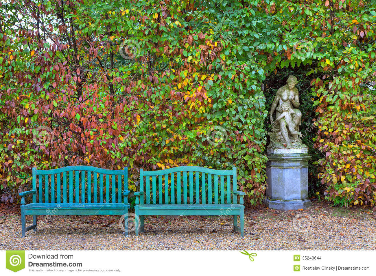 Wooden Park Benches Front Benches And Sculpture In Autumnal Park Stock Photo