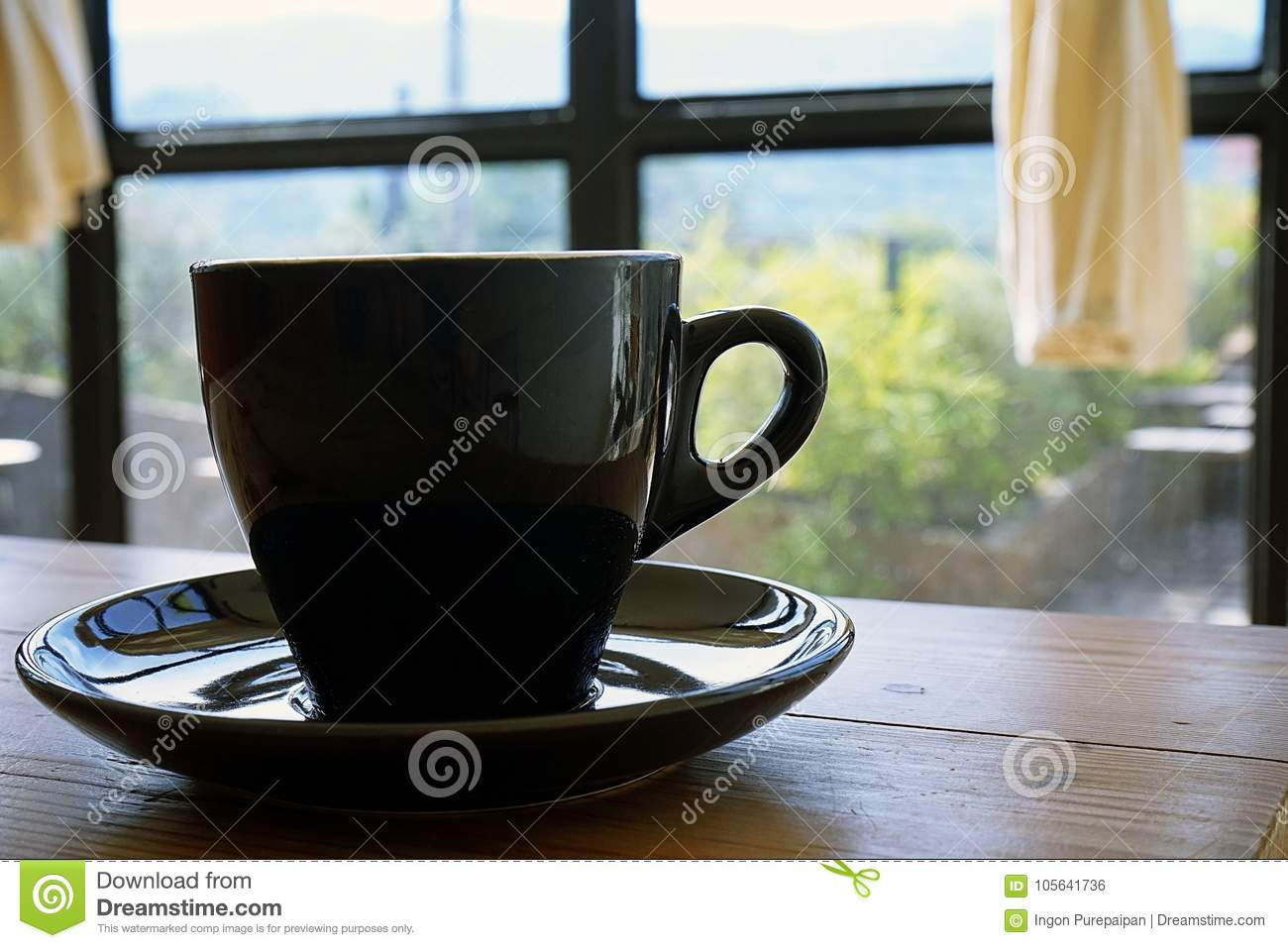 Bru Coffee Green Garden Black Cup With Steaming Hot Coffee On The Wooden Table