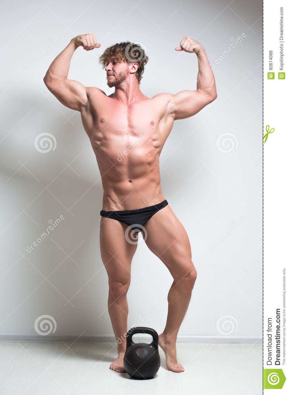 Kettlebell Bodybuilding Bodybuilder Against A White Wall Kettlebell Stock Photo Image