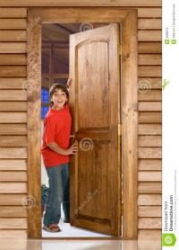 Boy at front door stock photo. Image of open, home, door ...