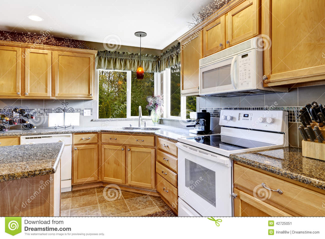 Brown Kitchen Cabinets With White Appliances Bright Kitchen Room Interior With White Appliances Stock