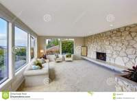 Bright Living Room With Rock Wall Trim And Fireplace Stock