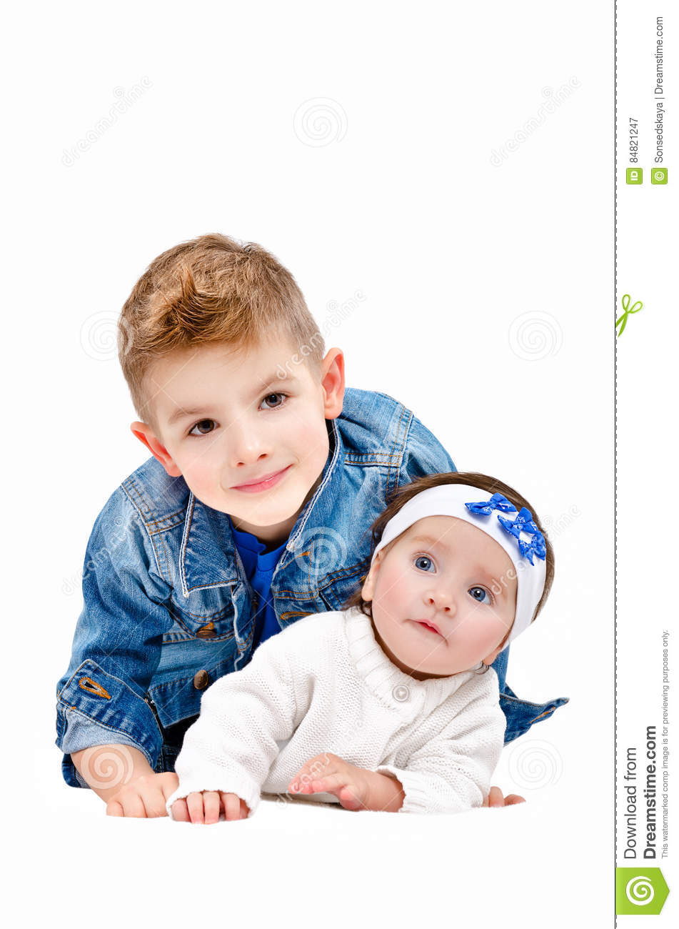 Toddler Kissing Newborn Elder Sister And Newborn Brother Royalty Free Stock Image