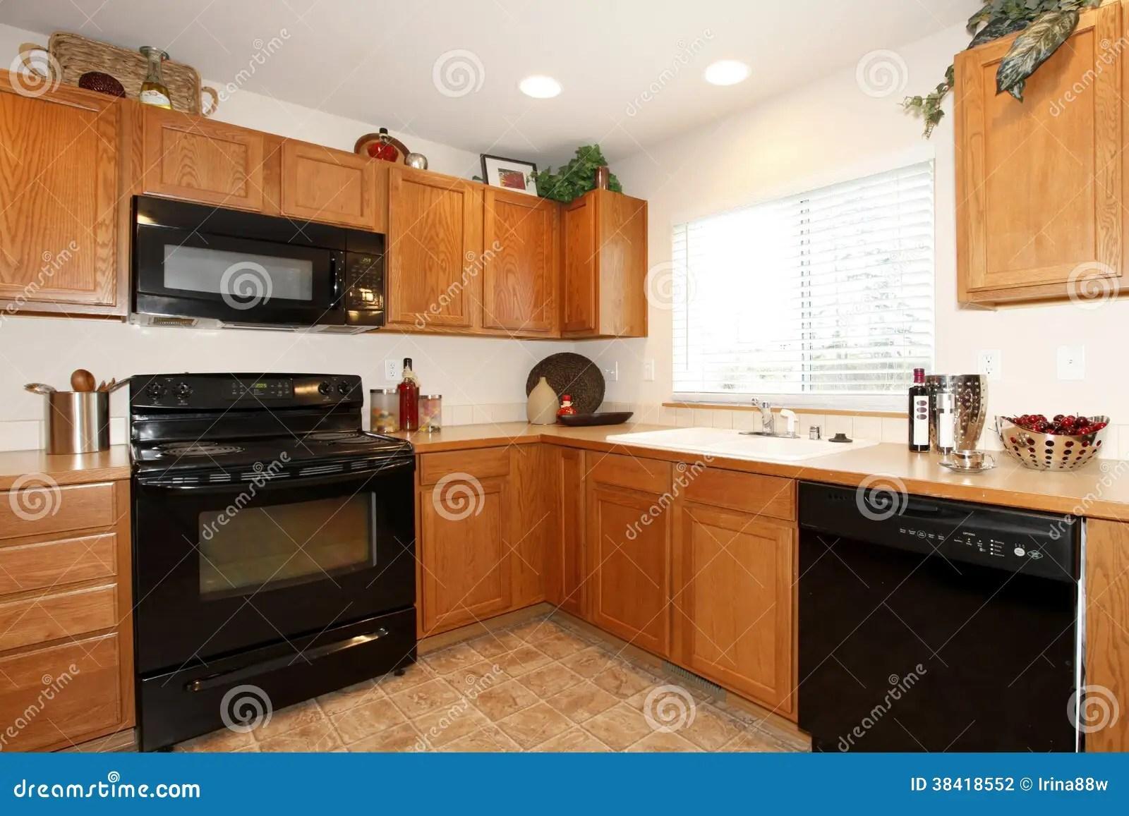 dark brown kitchen cabinets with black appliances brown kitchen cabinets Brown