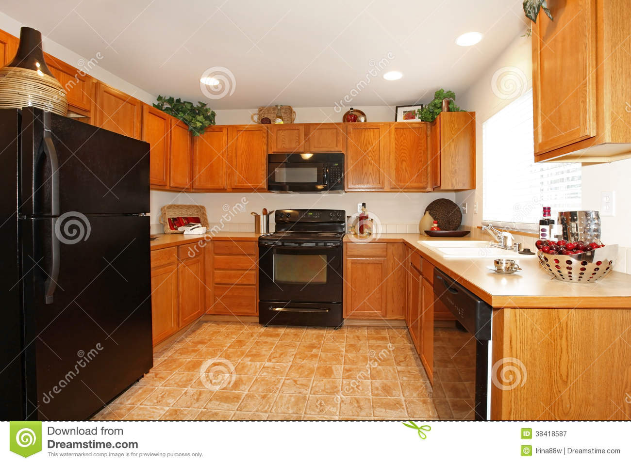 Brown Kitchen Cabinets With White Appliances Brown Kitchen Cabinets With Black Appliances Royalty Free