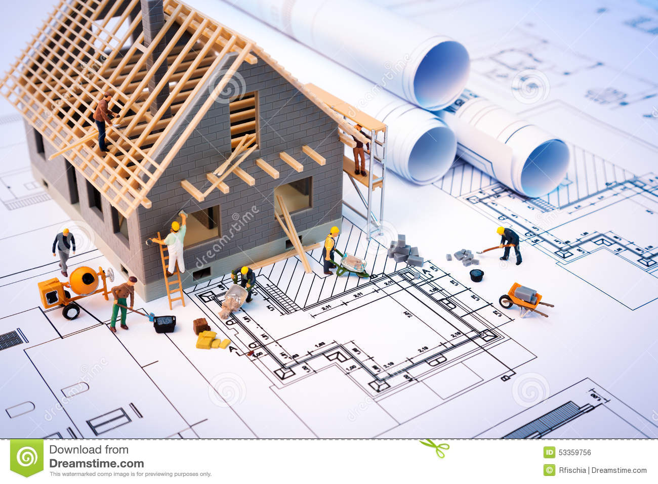 Building Construction Projects Building House On Blueprints With Worker Stock Photo