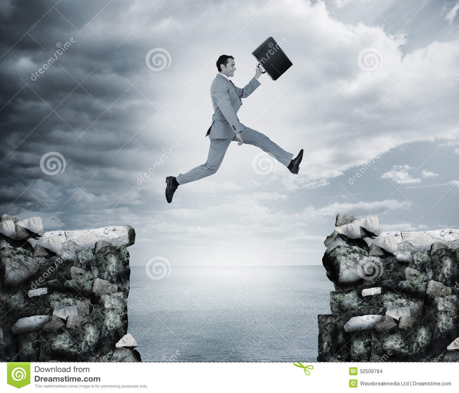 Businessman Quotes Wallpaper Businessman Jumping A Gap Between Cliffs Stock Images