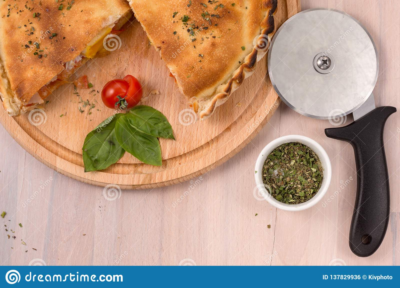 Pizza Roller Calzone Pizza And Roller Knife On Light Wooden Background Stock