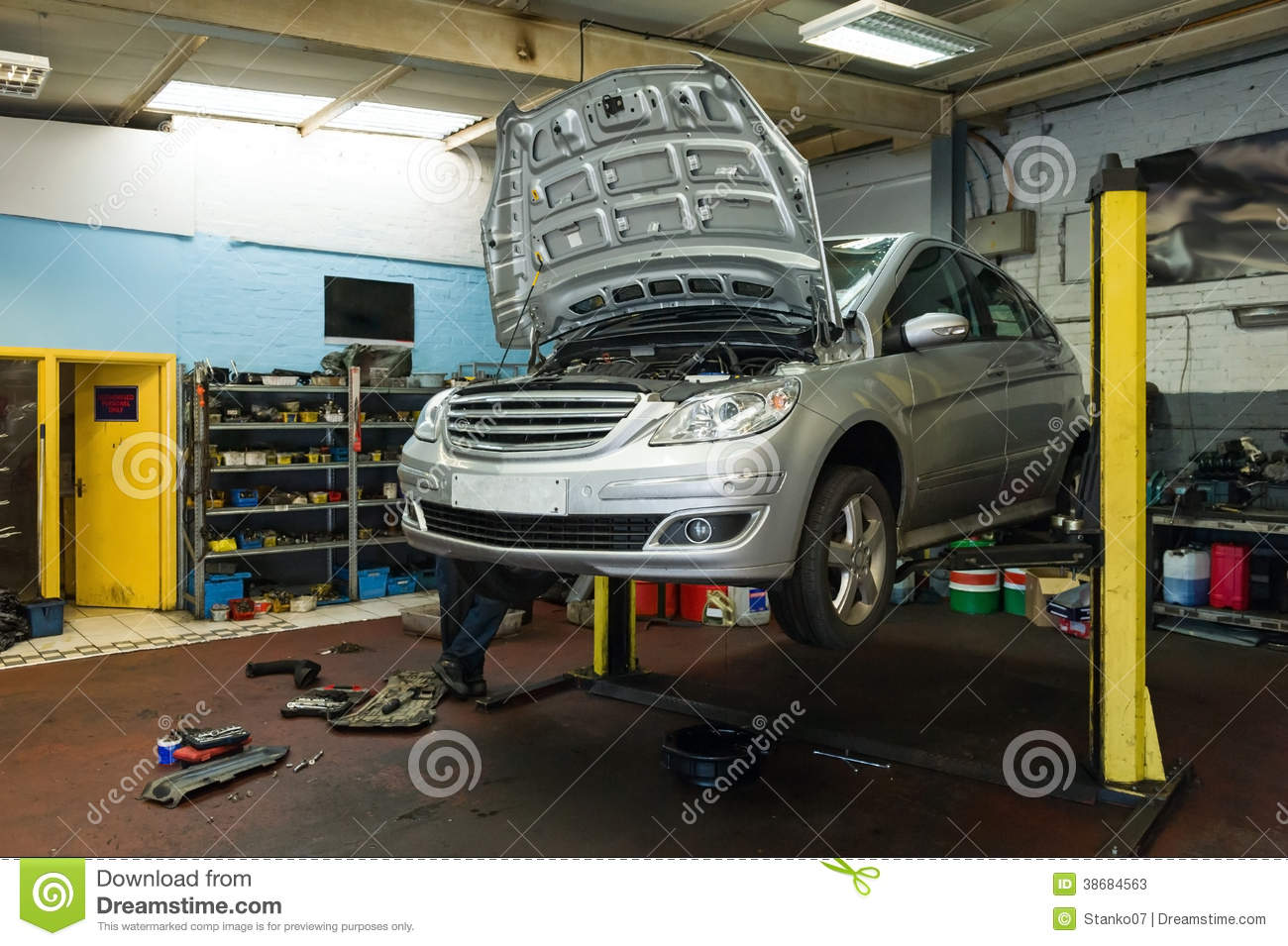 Garage Car Lift Images Car On A Lift In Garage Stock Image Image Of Engineering 38684563