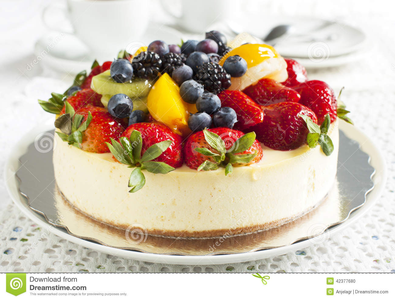 Fruit Decoration Gateau Orange Cheesecake Topped With Berries And Fruits Stock Photo