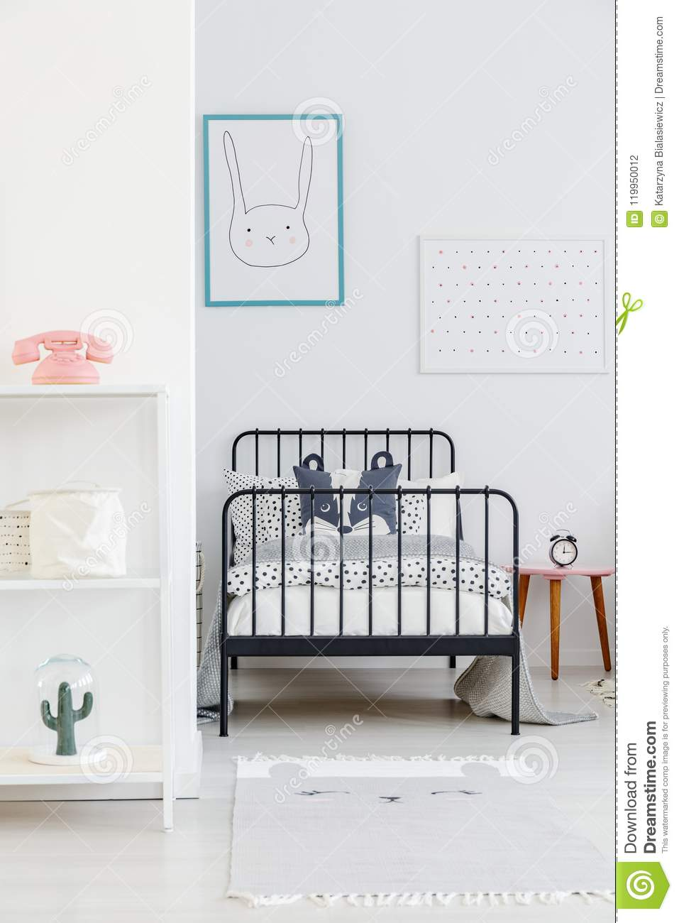 Simple Bed Childs Bed With Black Metal Frame In A Small Simple Bedroom In