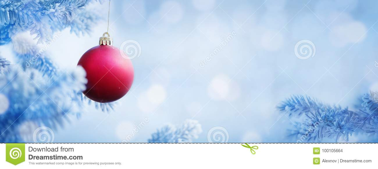 Christmas Background Of Red Ball On The Snow Blue Tree Stock Photo