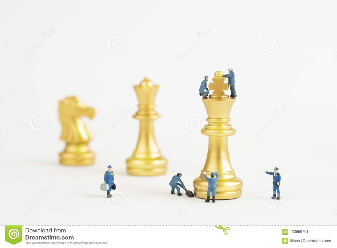 Gold Chess Pieces Close Up Golden Chess Pieces And Miniature People Stock Image
