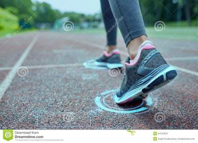 Close Up Of Woman Feet Running On Track From Back Stock ...