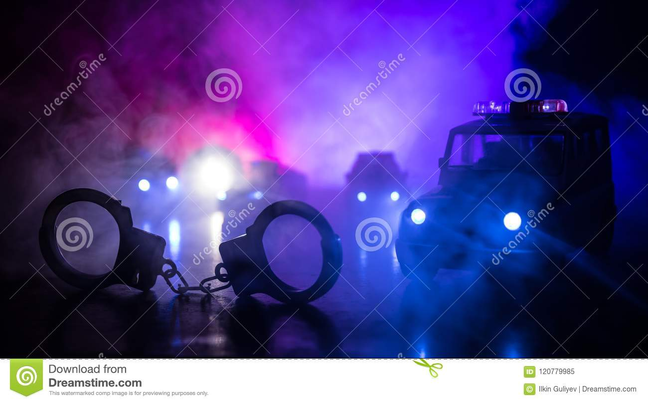 Closed Handcuffs On The Street Pavement At Night With Police Car Lights Stock Image Image Of System Blue 120779985