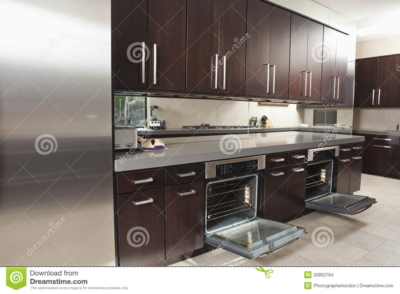 Commercial Countertop Dishwasher Commercial Kitchen With Open Oven And Cabinets Stock Photo