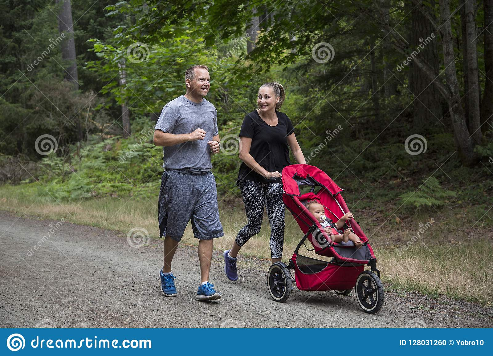Baby Pushing Pram Youtube Couple Exercising And Jogging Together Pushing Their Baby In