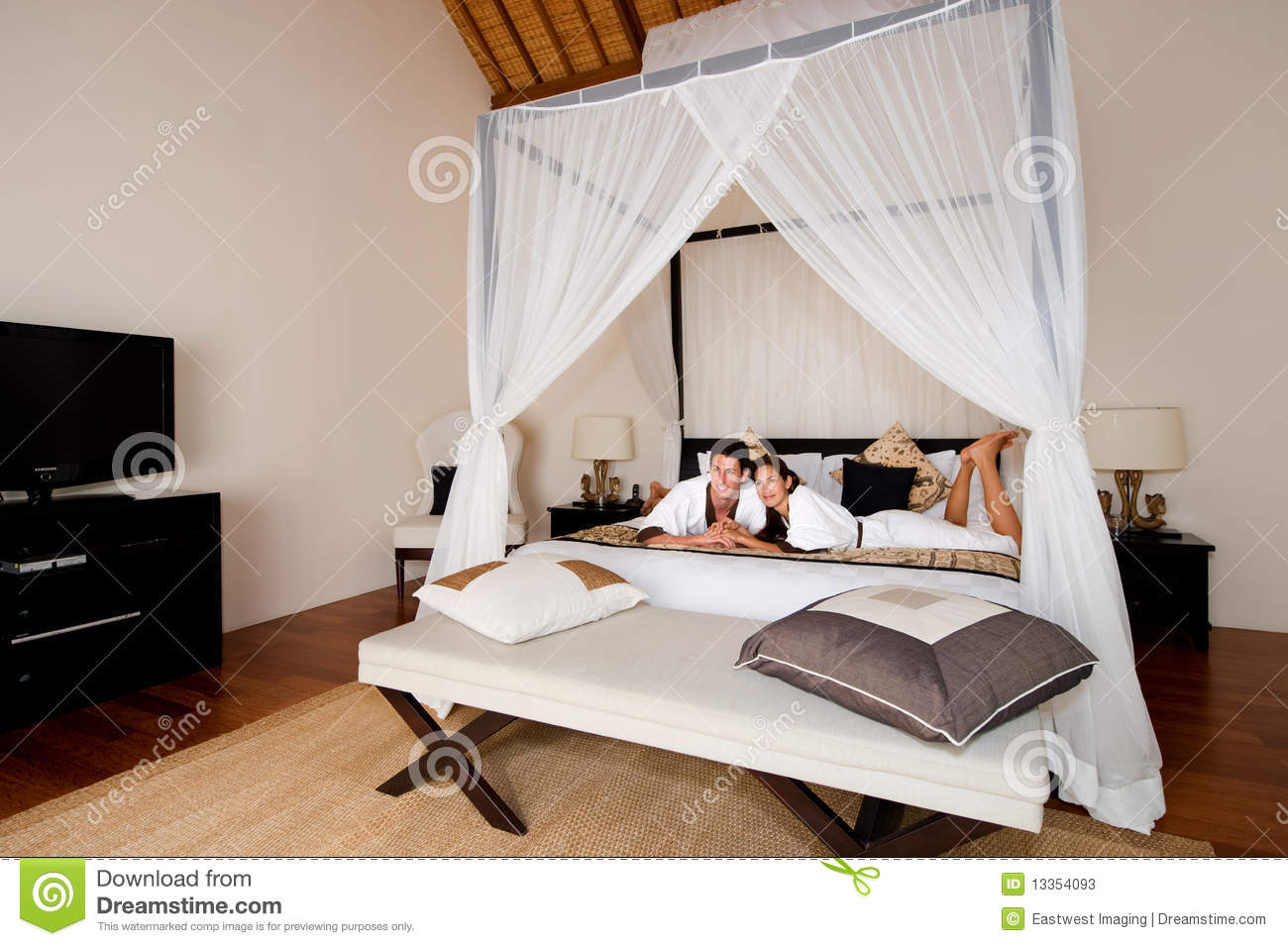 How To Be More Confident In Bed Couple Relaxing In Bedroom Stock Photos Image 13354093