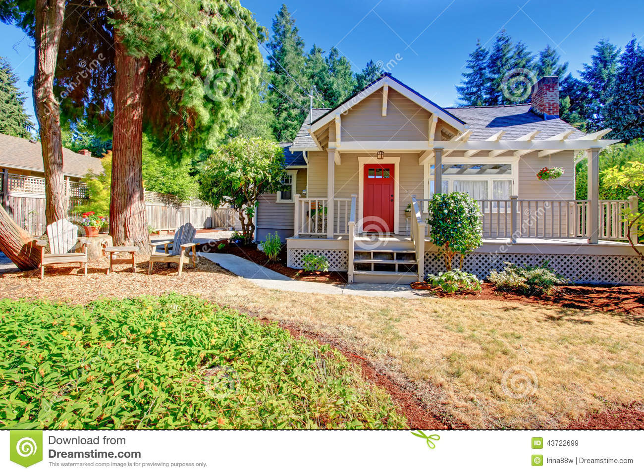 Cozy small house with outdoor rest area stock photo