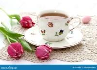Cup Of Tea And Tulips On Beautiful Napkin Stock Photo ...