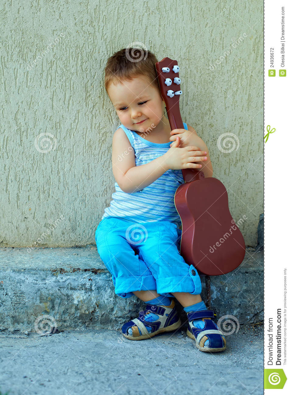 Cute Baby Attitude Wallpaper Cute Baby Boy With Guitar Sitting Against Wall Stock Photo