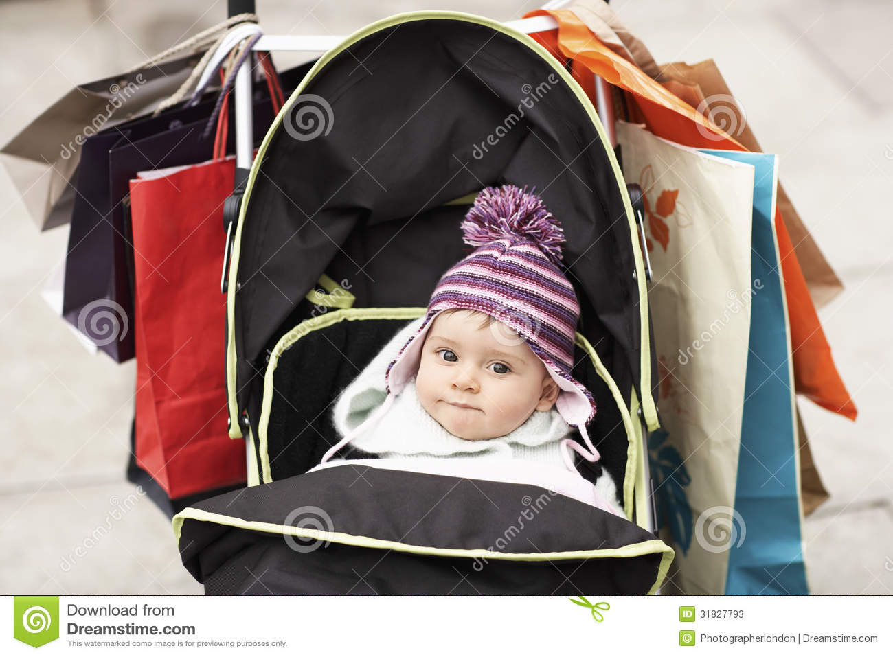 Child With A Pram Cute Baby In Stroller Hung With Shopping Bags Stock Image