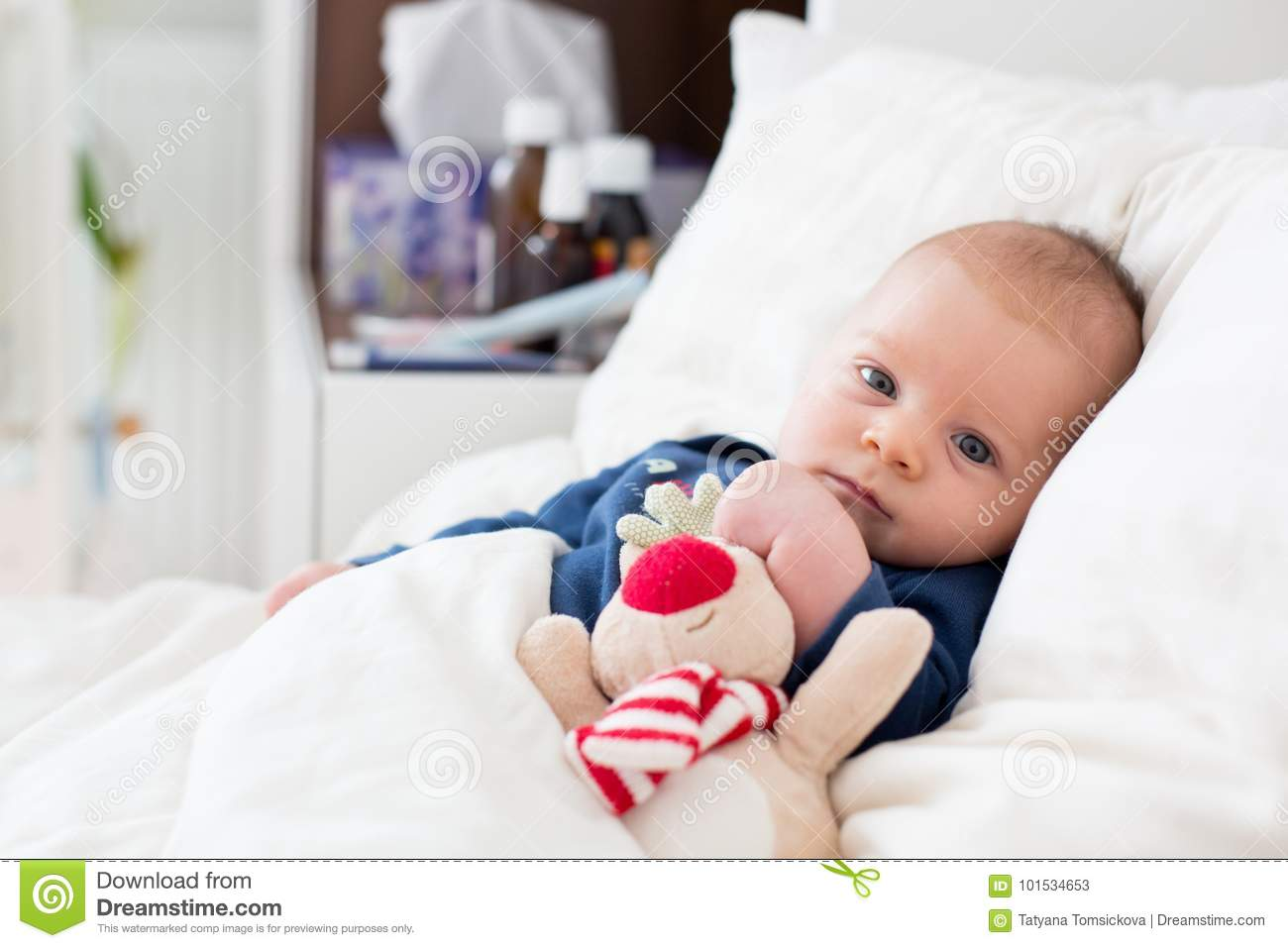 Newborn Infant With Fever Cute Newborn Baby Boy Lying In Bed With Cold Stock Image