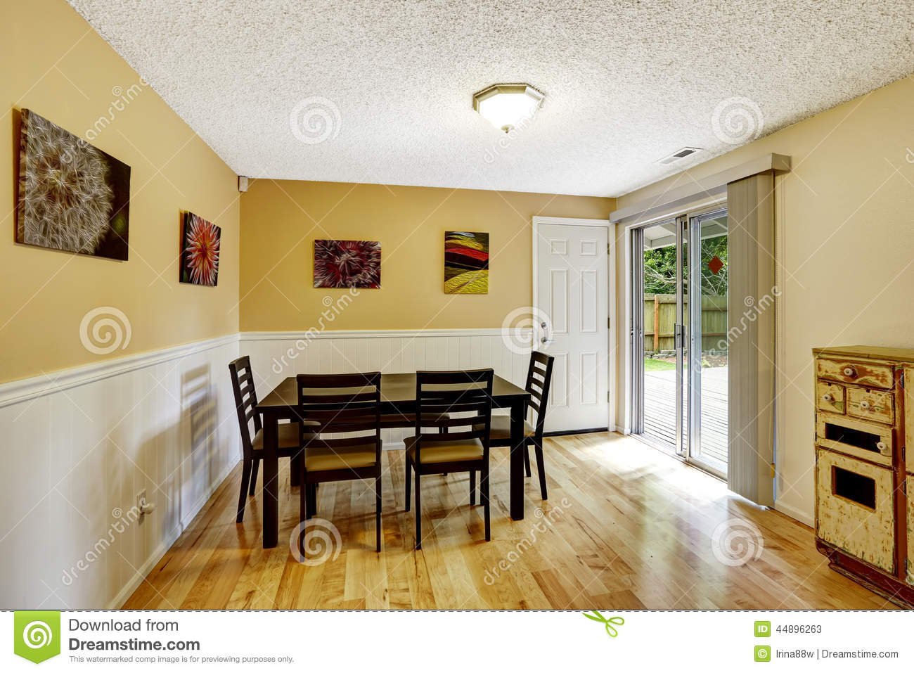 Yellow Dining Room Walls Dining Room With Exit To Backyard Patio Area Stock Photo