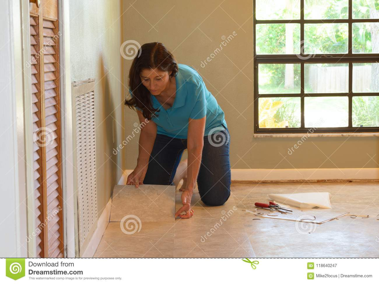 Installing Vinyl Tile Diy Homeowner Woman Or Professional Installing Vinyl Tile Flooring
