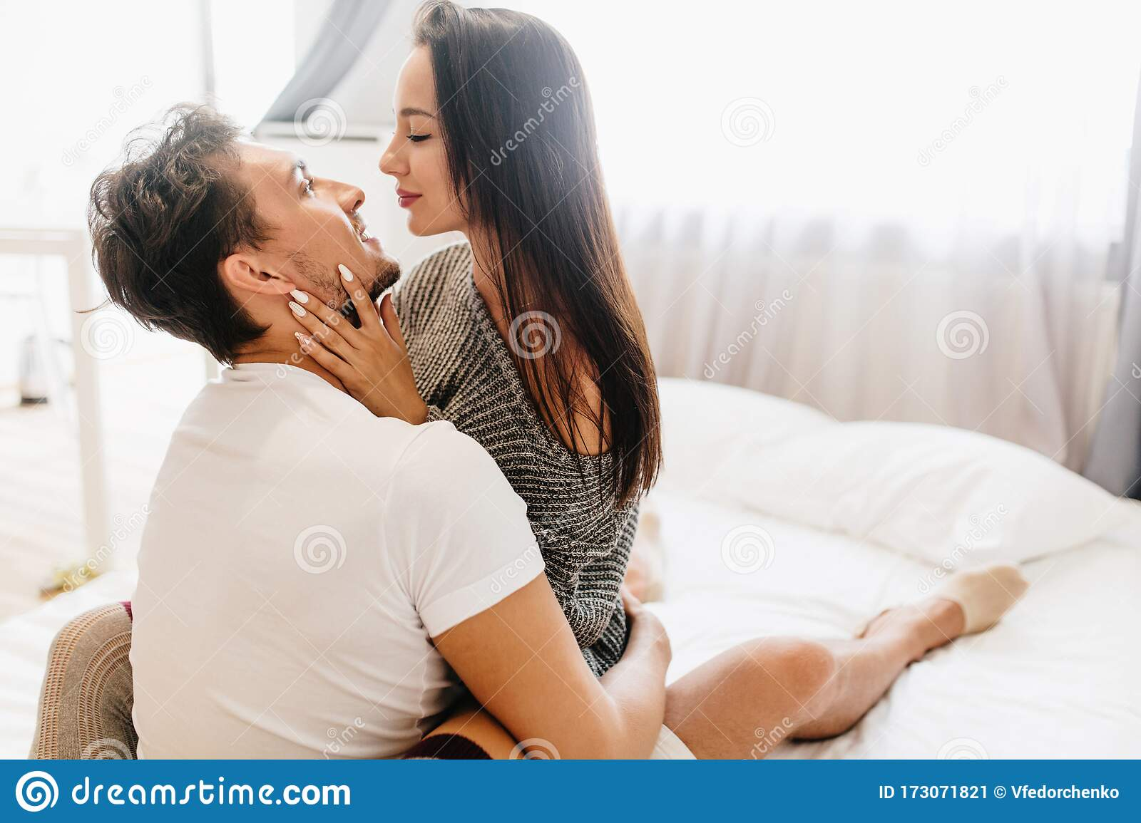 Enchanting Girl With White Manicure Chilling In Bed With Husband And Gently Touching Him Indoor Portrait Of Gorgeous Stock Image Image Of Comfortable Boyfriend 173071821