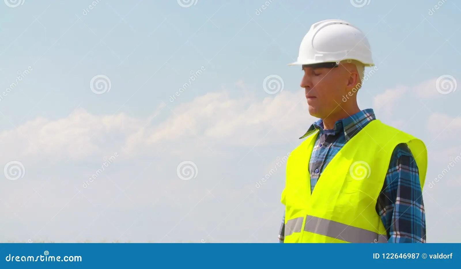 Engineer Reading BluePrint And Working On Alternative Energy