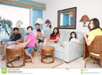 Family Relaxing In Living Room Royalty Free Stock Photo