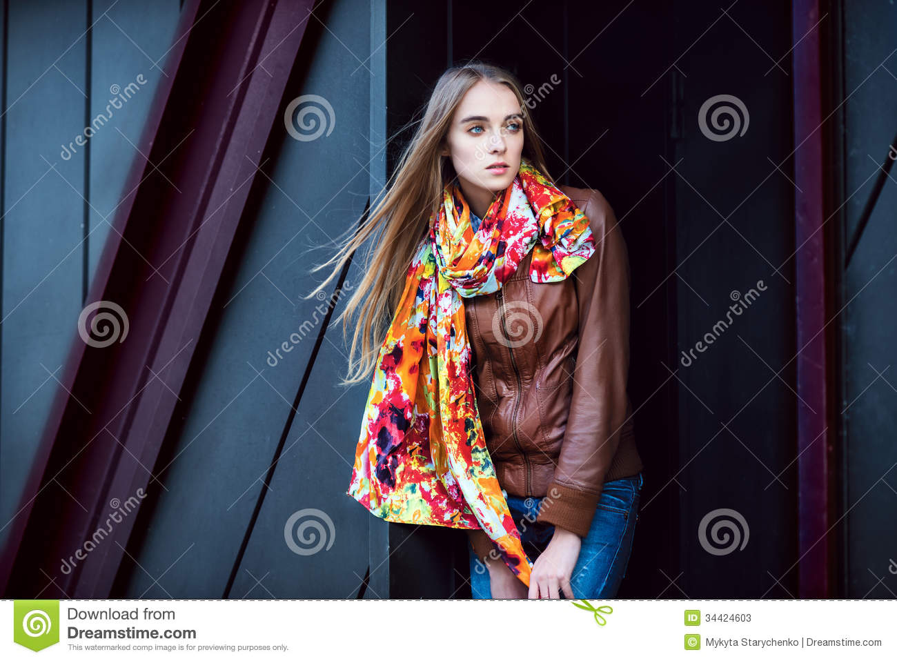 Fashion Woman Wearing Leather Coat And Scarf Posing