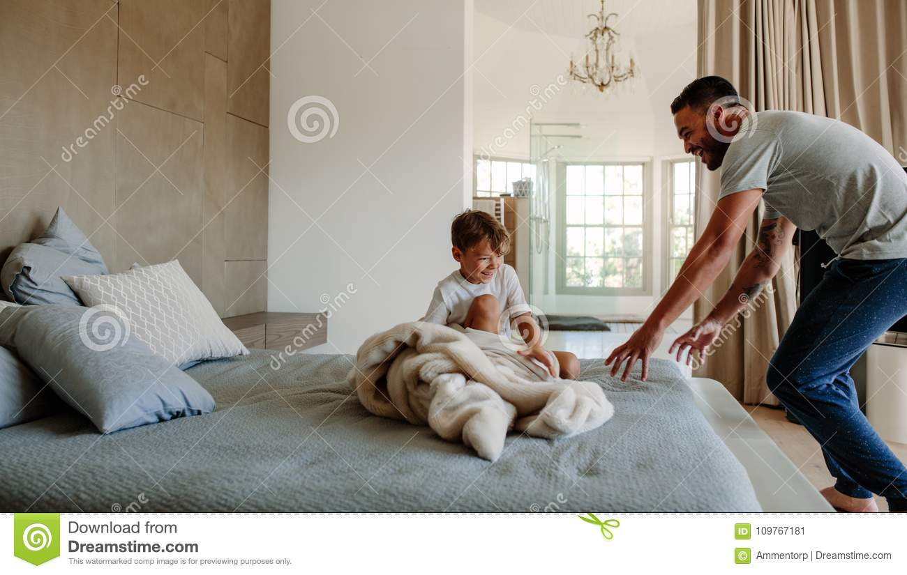 Little Couch For Bedroom Father And Son Playing In Bedroom Stock Image Image Of Little
