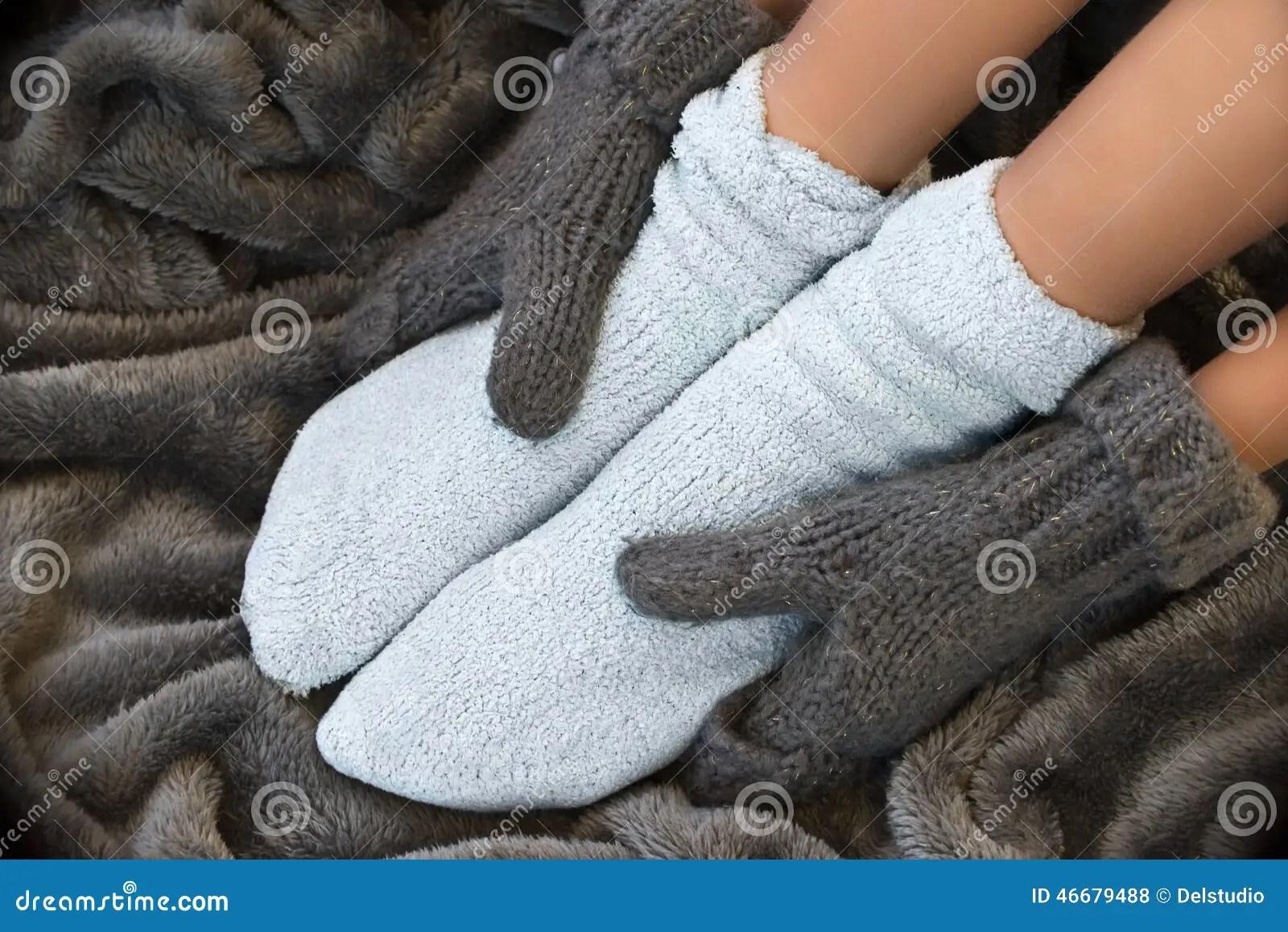 Feet In Comfortable And Warm Woolen Socks Stock Photo