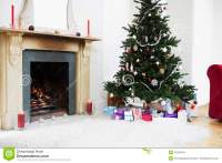 Fireplace And Christmas Tree With Presents Stock Photo