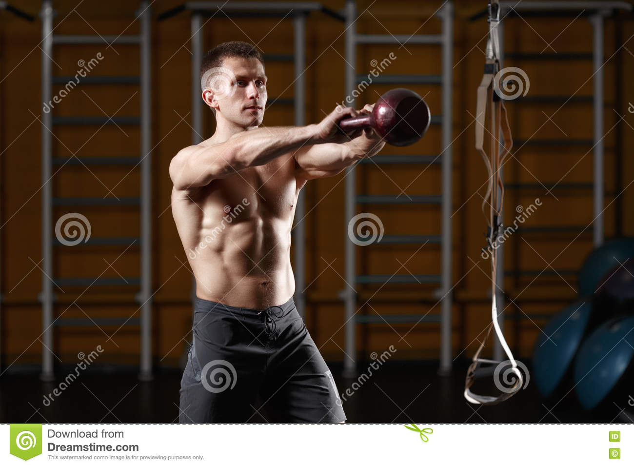 Kettlebell Bodybuilding Fitness Man Doing A Weight Training By Lifting Kettlebell Stock