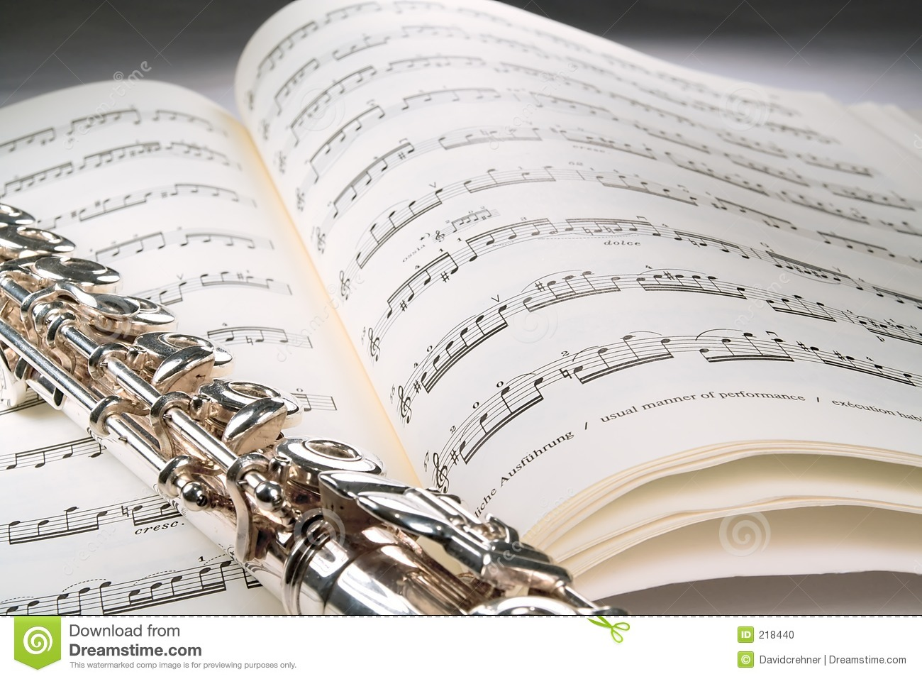 Cute Wallpapers Drawing Flute On An Open Musical Score With Gray Background Stock