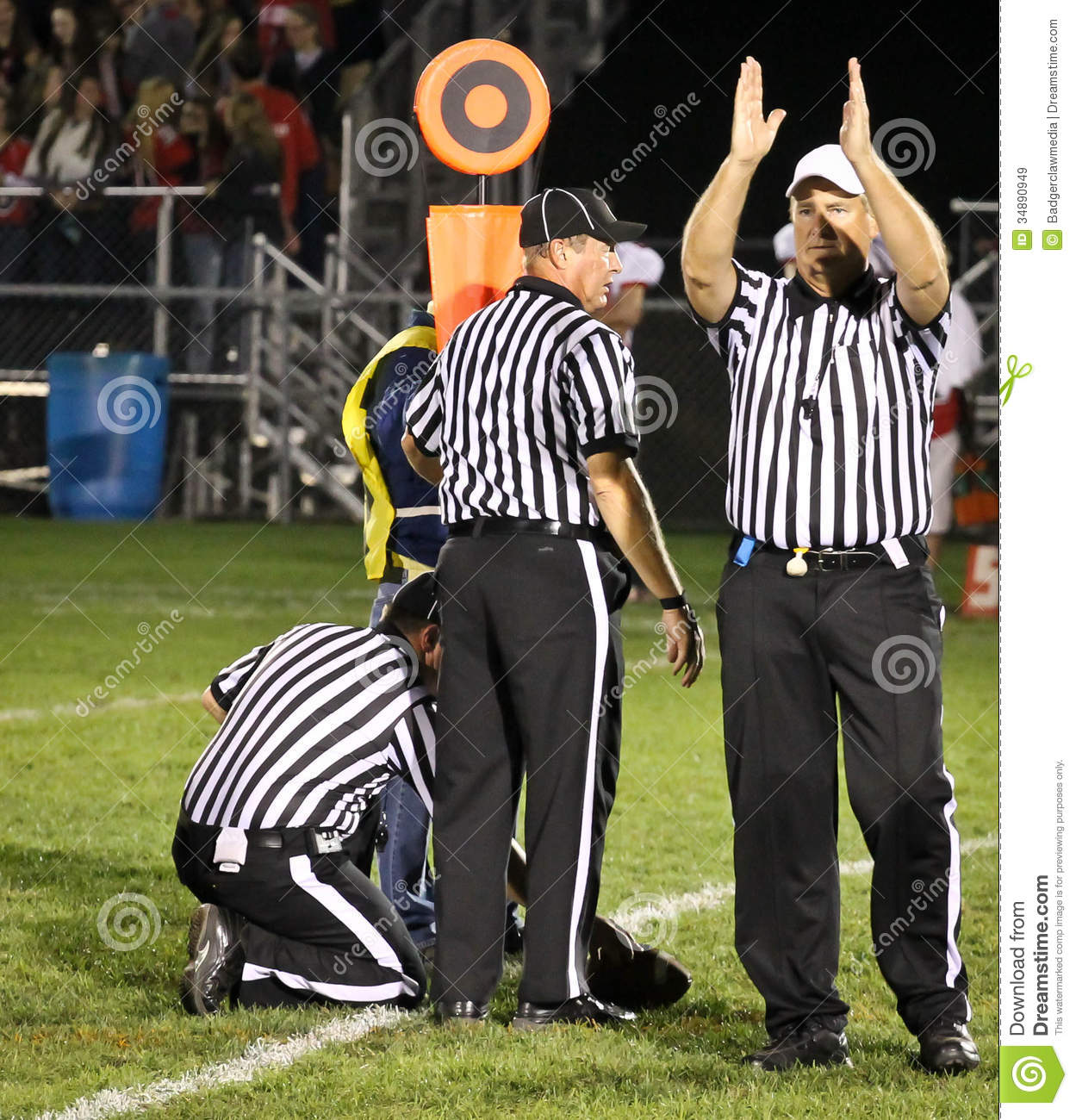 football referees gesturing fourth down and short