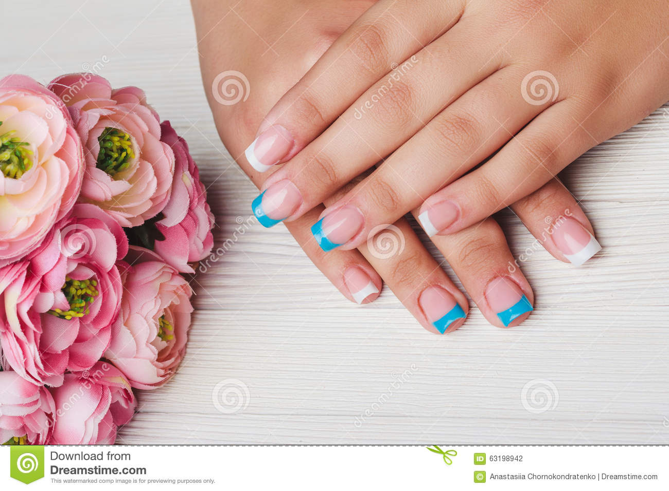 French Nail Art In Light Blue And White Color Stock Photo
