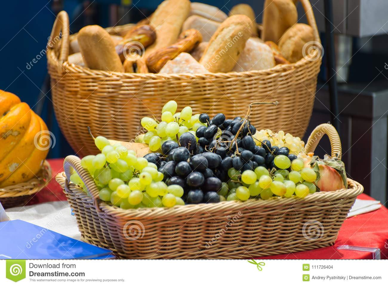 Table Top Fruit Basket Fruit Basket And Bread Basket On The Table Stock Photo