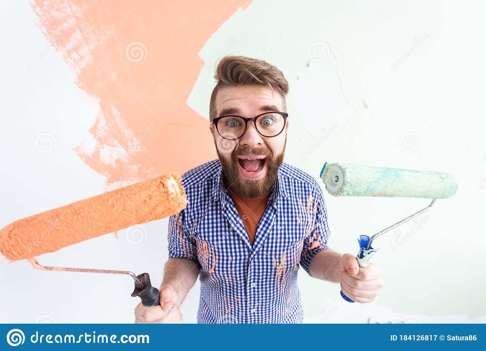 Funny Man Painting Interior Wall Of Home With Paint Roller Redecoration Renovation Apartment Repair And Refreshment Stock Image Image Of Humor Fool 184126817