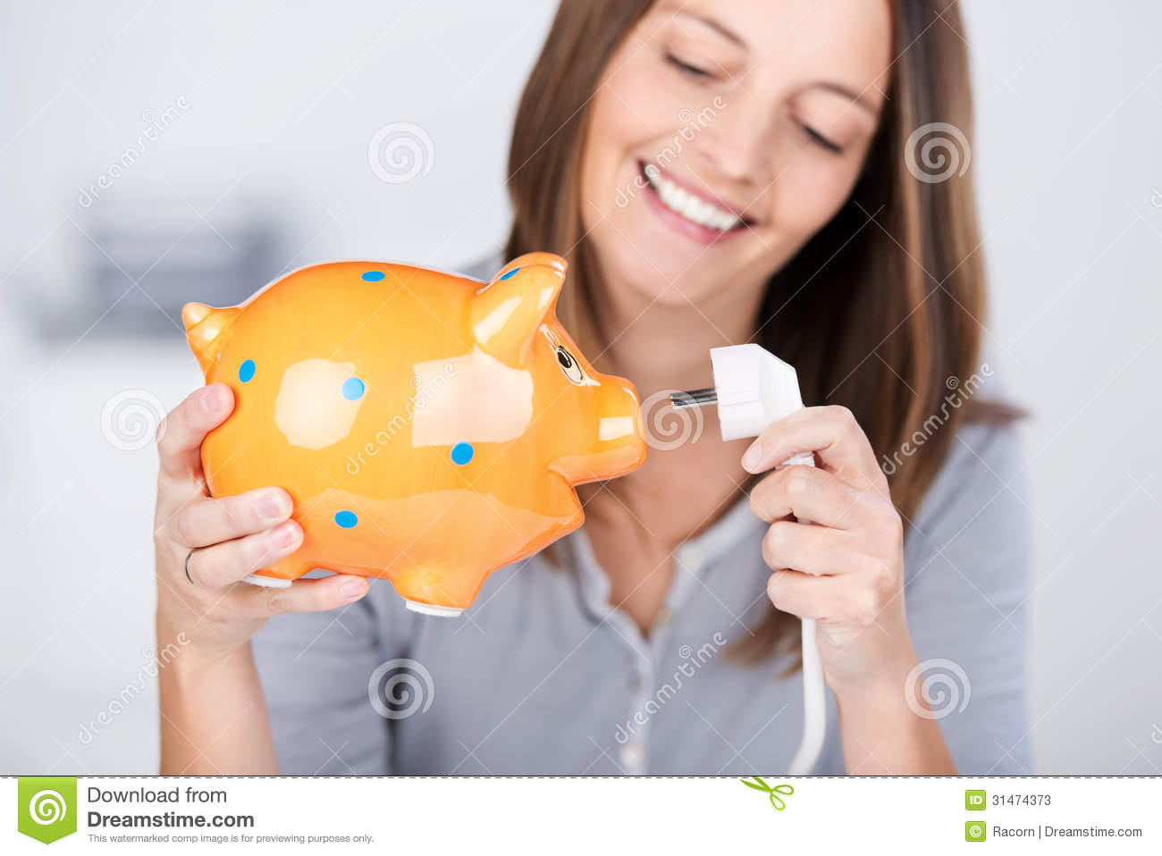 Piggy Bank Adult Funny Woman Holding Electric Plug And Piggy Bank Stock