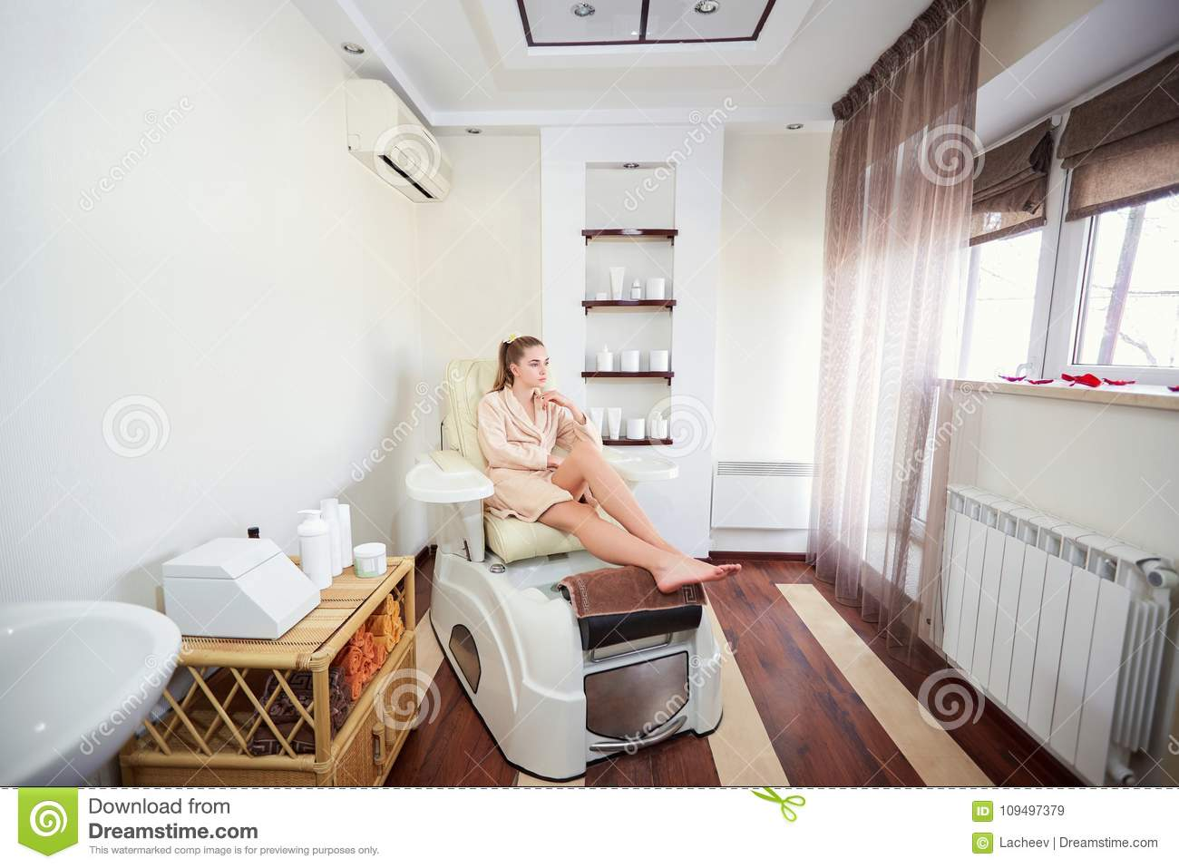 Pedicure Salon A Girl In A Pedicure Salon Sitting In A Chair Stock Image Image