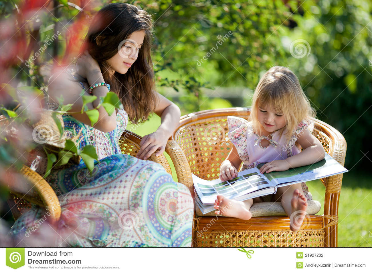 Outdoor Reading Chair Girl Reading Book Sitting In Wicker Chairs Outdoor Stock