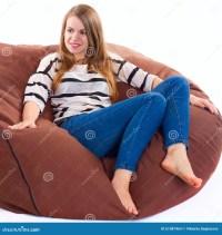 Girl Sitting On A Braun Beanbag Chair. Royalty-Free Stock ...