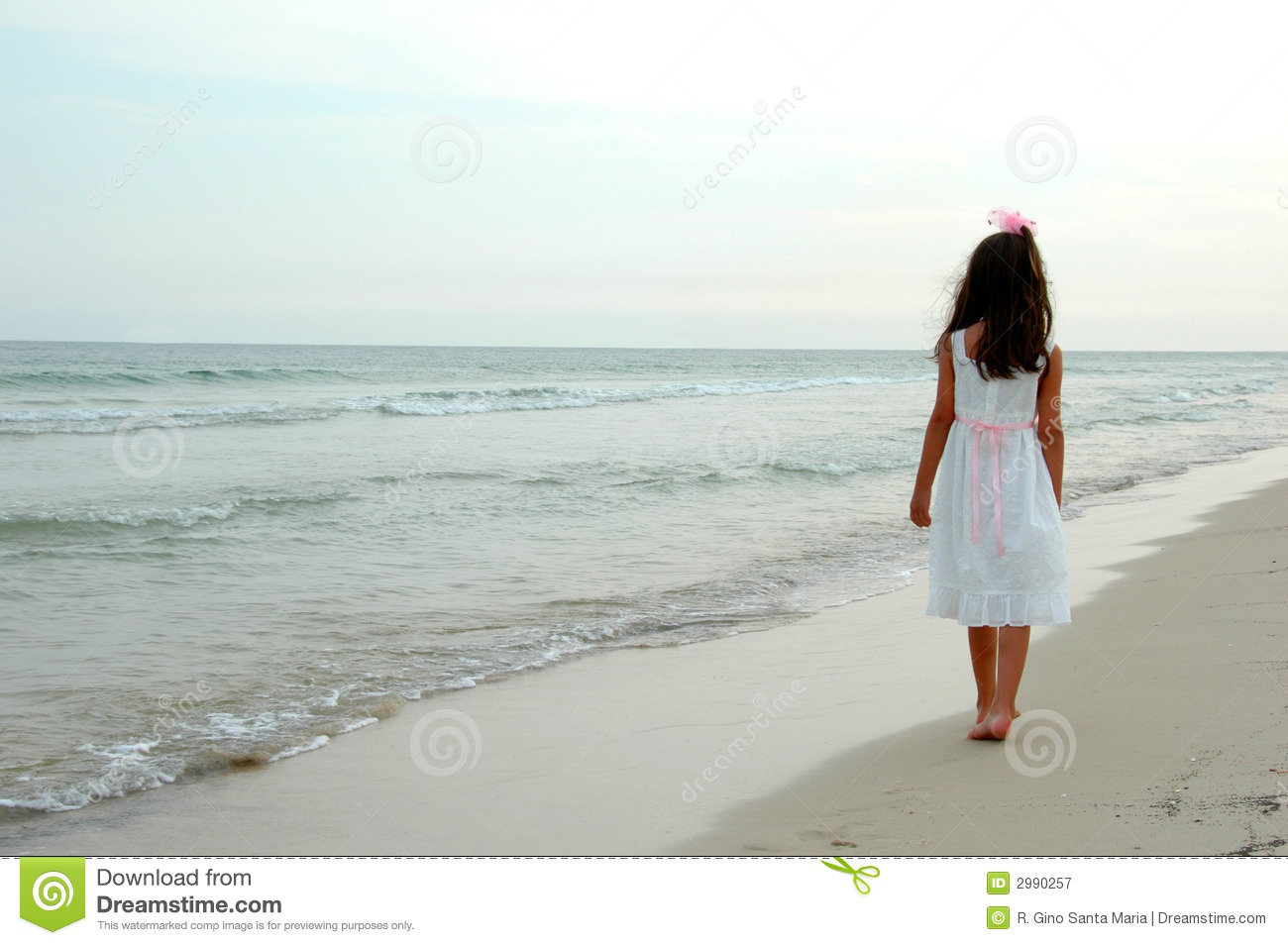 Girl walking on beach