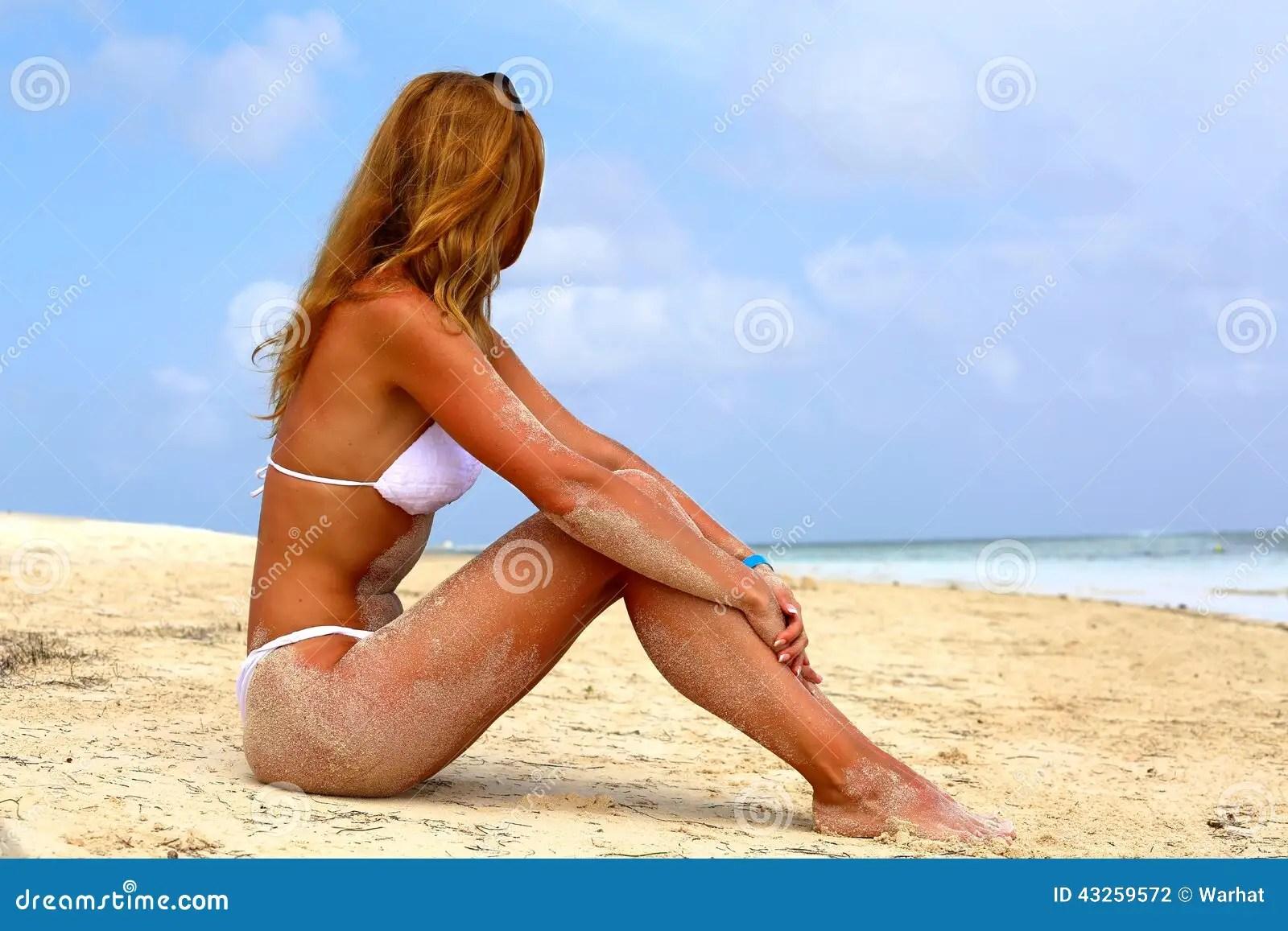 Hawaiian Tropic Girl Wallpaper Girl In A White Bikini With Long Hair Sits On A Sand Beach