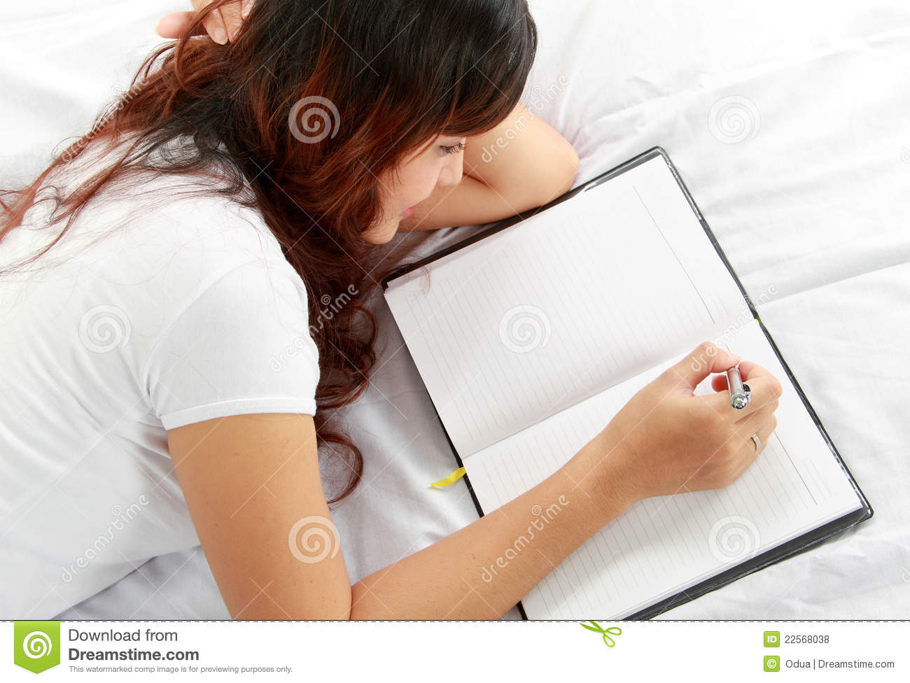 How To Be More Confident In Bed Girl Writing Book On The Bed Stock Photo Image Of